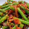 Kruidige sperziebonen met tomaat
